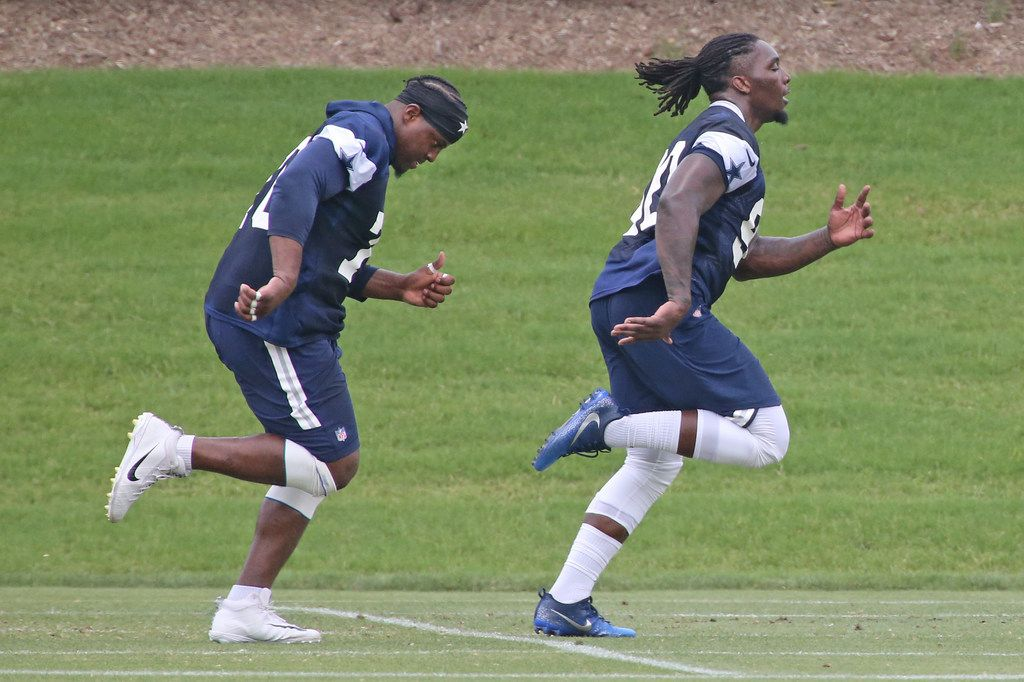 Dallas Cowboys defensive ends Demarcus Lawrence (90), right, and Kony Ealy (76) run during a drill at Dallas Cowboys mandatory minicamp in Frisco, Texas, on Monday, June 12, 2018. (Louis DeLuca/The Dallas Morning News)