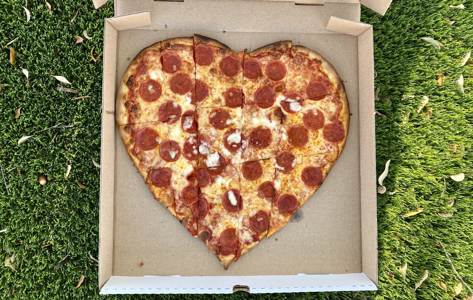 Mimi's Pizzeria serves heart-shaped pizzas for Valentine's Day this year.