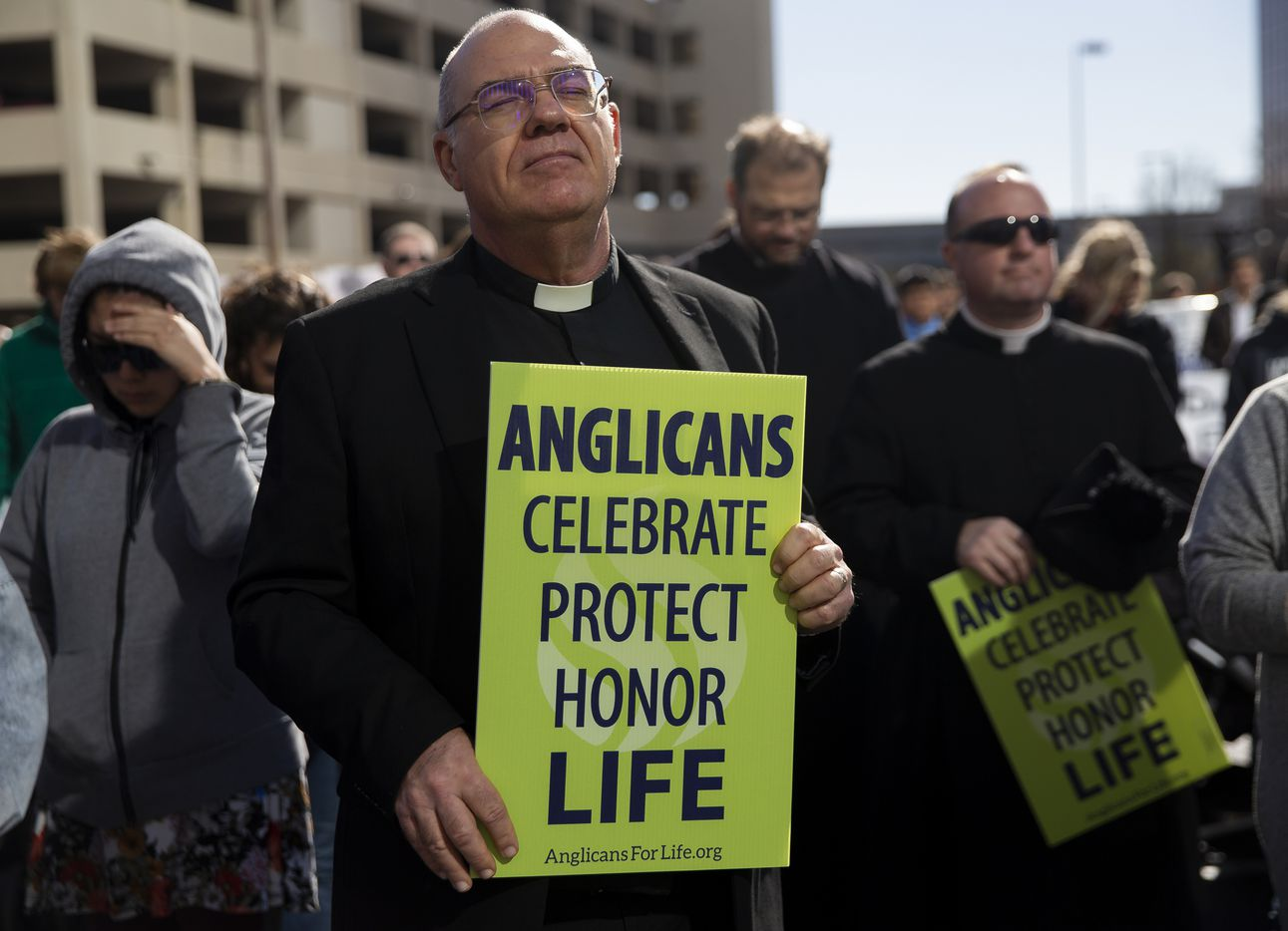 Father Adams (left) from Episcopal Diocese of Fort Worth prays after marching from the Cathedral Santuario de la Virgen de Guadalupe to the Earle Cabell Federal Courthouse during the North Texas March for Life on Saturday, Jan. 18, 2020.