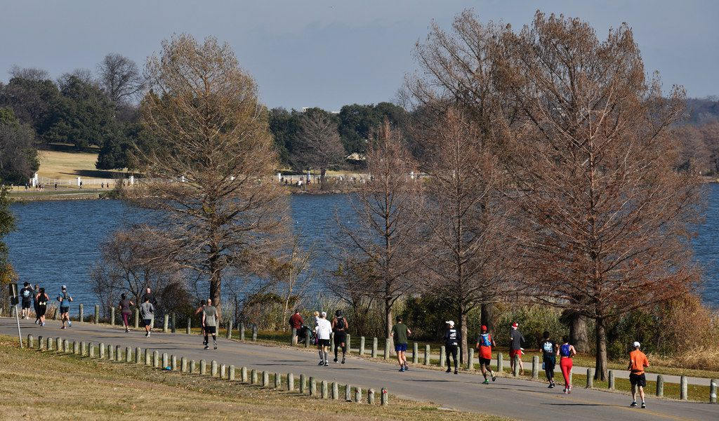 Runners alongside White Rock Lake during this year's BMW Dallas Marathon, Sunday Dec. 15, 2019 in Dallas. Ben Torres/Special Contributor