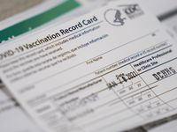 Vaccination record cards sit ready at a station at the Dallas County COVID-19 mega-vaccination site at Fair Park on Friday, Jan. 22, 2021, in Dallas. (Smiley N. Pool/The Dallas Morning News)