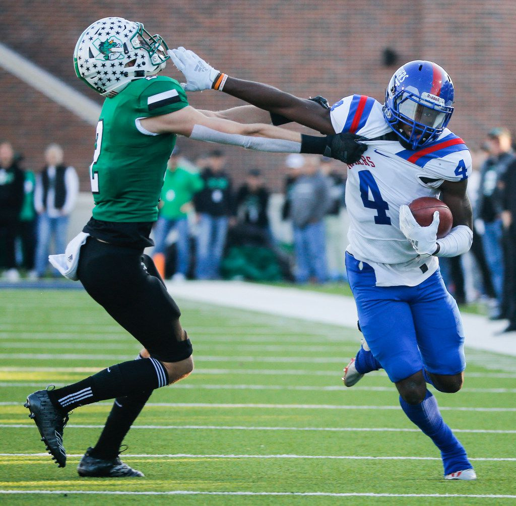 Duncanville wide receiver Zeriah Beason (4) breaks past Southlake Carroll defensive back Dylan Thomas (2) during the second half of a Class 6A Division I Region I high school football matchup between Southlake Carroll and Duncanville on Saturday, Dec. 7, 2019 at McKinney ISD Stadium in McKinney, Texas. (Ryan Michalesko/The Dallas Morning News)