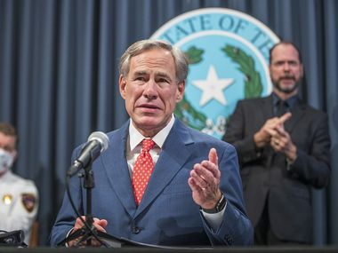 Gov. Greg Abbott, shown at a COVID-19 press conference from early last month, on Monday broke his silence on the presidential race, joining the chorus of people who want to let the presidential election play out with vote counts and, where state laws allow, recounts.