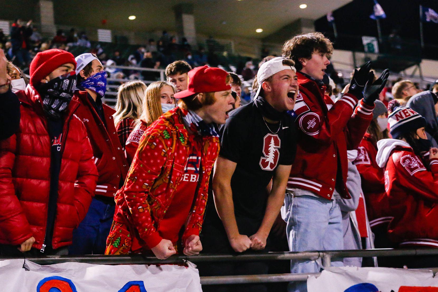 Denton Ryan football fans celebrate a play against Frisco Lone Star during the fourth quarter at the C.H. Collins Complex in Denton on Thursday, Dec. 4, 2020. Denton Ryan won, 35-21. (Juan Figueroa/ The Dallas Morning News)