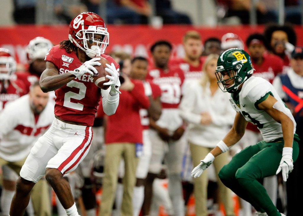 Oklahoma Sooners wide receiver CeeDee Lamb (2) pulls in a pass completion before racing down the sideline for a first-quarter touchdown against the Baylor Bears in the Big 12 Championship at AT&T Stadium in Arlington, Saturday, December 7, 2019.