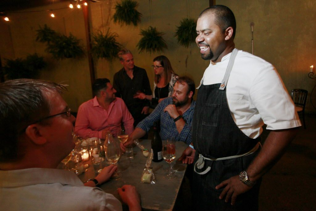 Chef de Cuisine Nilton Borges Jr., right, speaks with Matt Balke, left, as he congratulated the chef on his food during the food preview of Uchi restaurant.
