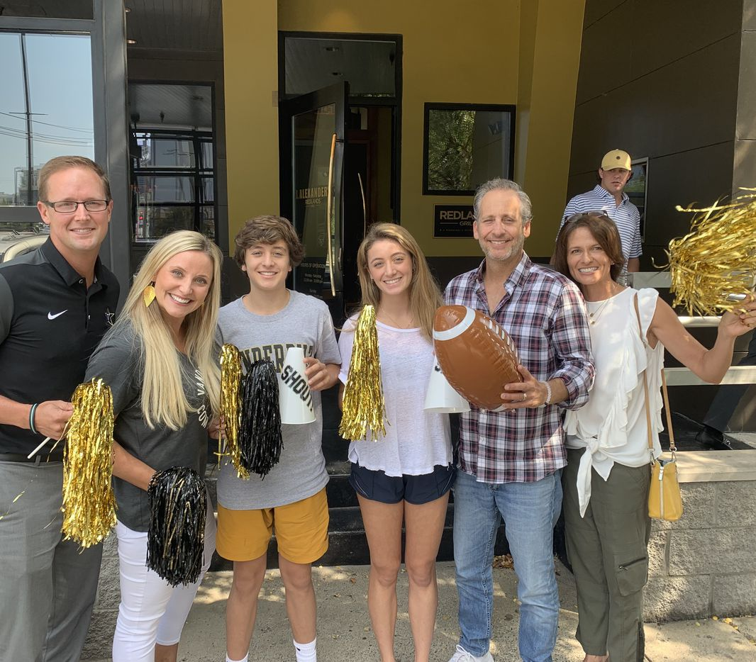 From left: Clayton and Kerry Arrington, vice president of Varsity Spirit, with the Blumenfelds — Ben, Alexandra, Adam and Christy — at Vanderbilt University's homecoming in 2019.