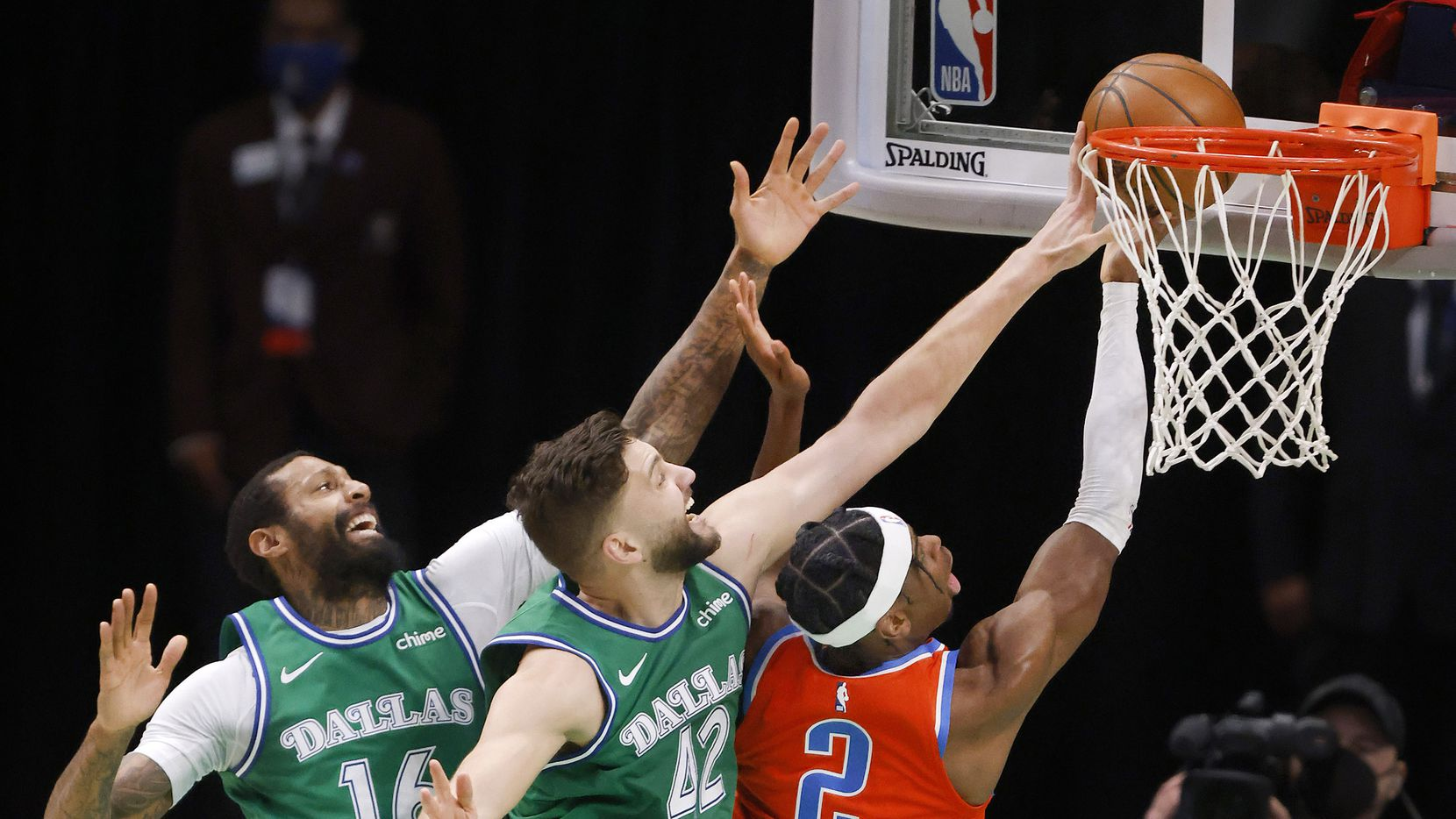 Dallas Mavericks forward Maxi Kleber (42) was called for the foul as he attempts to block Oklahoma City Thunder guard Shai Gilgeous-Alexander's (2) layup during the first quarter at the American Airlines Center in Dallas, Wednesday, March 3, 2021. Assisting on the play is Dallas Mavericks forward James Johnson (16).