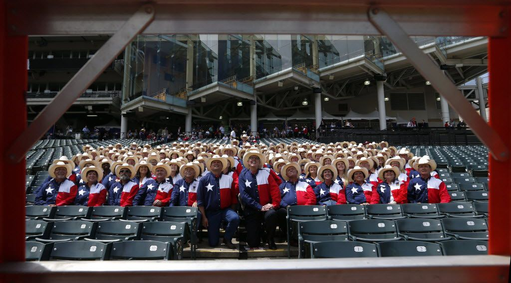 """Texas delegates took a group photo in their """"uniform"""" at Progressive Field in Cleveland on Monday. Kneeling at center are Lt. Gov. Dan Patrick (right) and state GOP chairman Tom Mechler."""