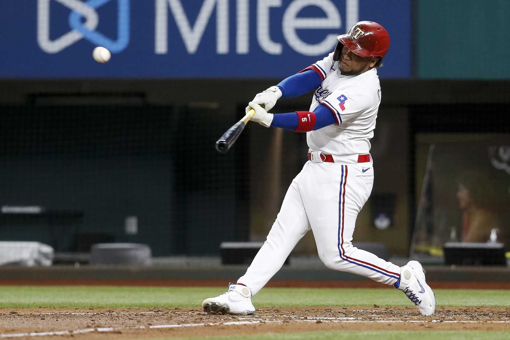 Texas Rangers left fielder Willie Calhoun (5) hits the ball during the third inning against the Oakland Athletics at Globe Life Field on Tuesday, June 22, 2021, in Arlington. (Elias Valverde II/The Dallas Morning News)