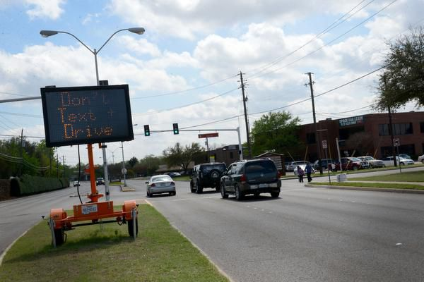 A digital message board warns drivers not to text and drive near Neil Ray McLaughlin Elementary School and Nancy H. Strickland Elementary School while students are released for the day. In March, Farmers Branch passed a new rule making texting and driving illegal in the city.