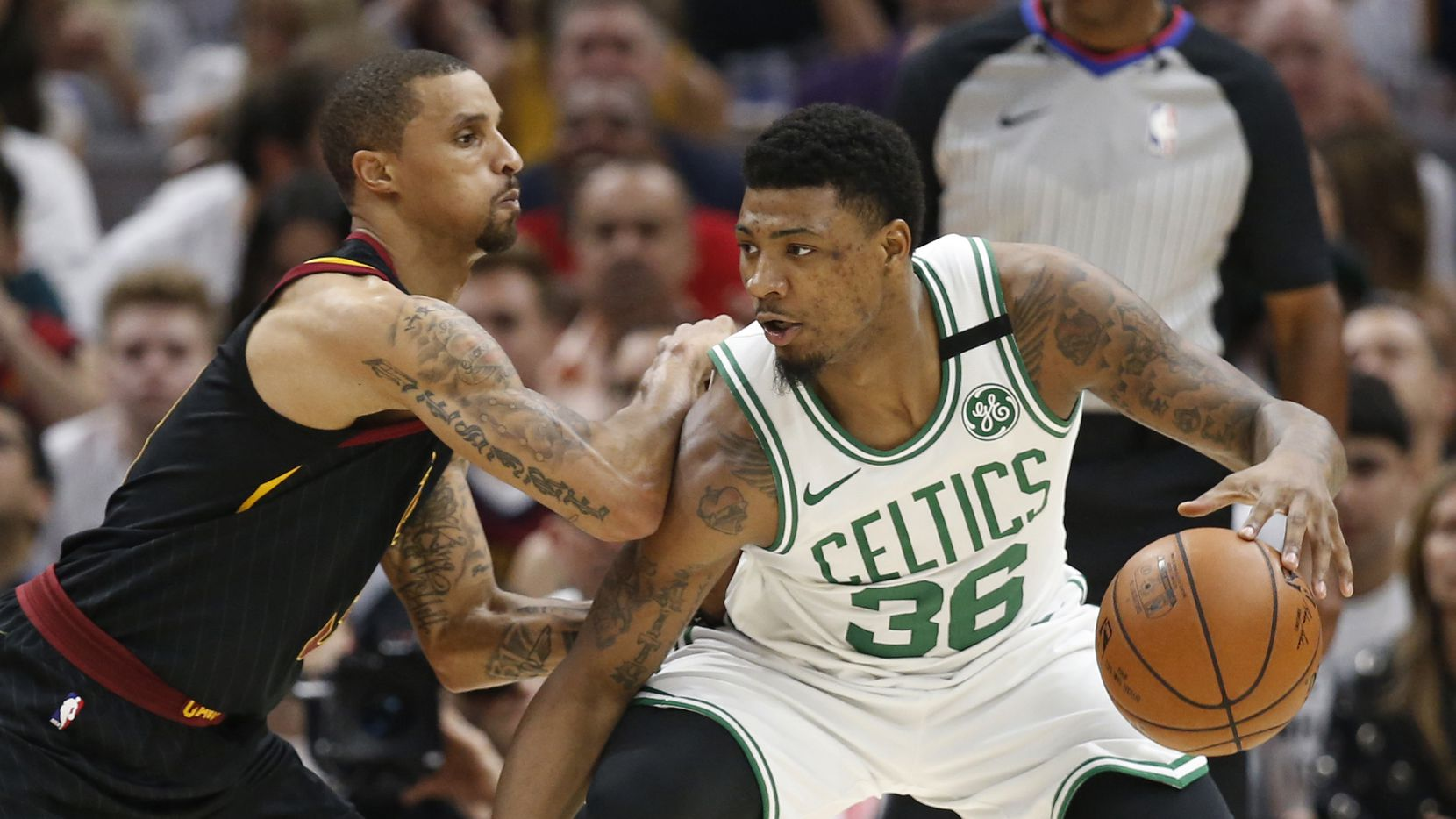 Boston Celtics' Marcus Smart (36) drives past Cleveland Cavaliers' George Hill (3) during the first half of Game 6 of the NBA basketball Eastern Conference finals Friday, May 25, 2018, in Cleveland.