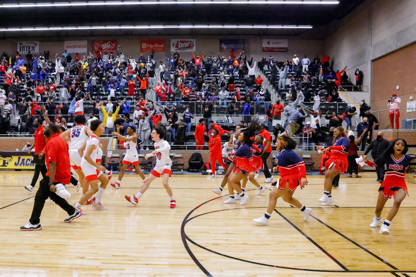Kimball celebrates their win over Lancaster following overtime of a boys basketball UIL Class 5A Region II playoff game against in Forney on Friday, March 5, 2021. (Juan Figueroa/ The Dallas Morning News)