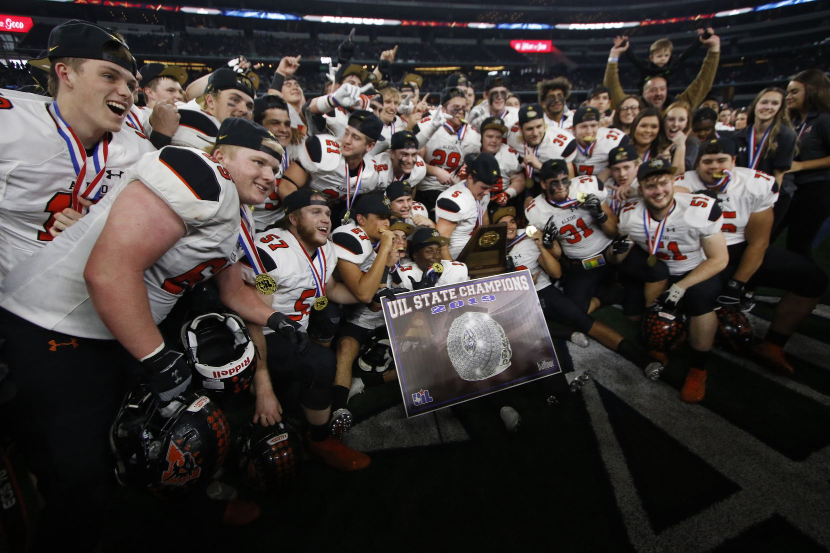 Members of the Aledo Bearcats pose for a photo with their medals and championship trophy following their 45-42 victory over Fort Bend Marshall to capture the state championship. The two teams played their Class 5A Division ll state championship football game at AT&T Stadium  in Arlington on December 21, 2019. (Steve Hamm/ Special Contributor)