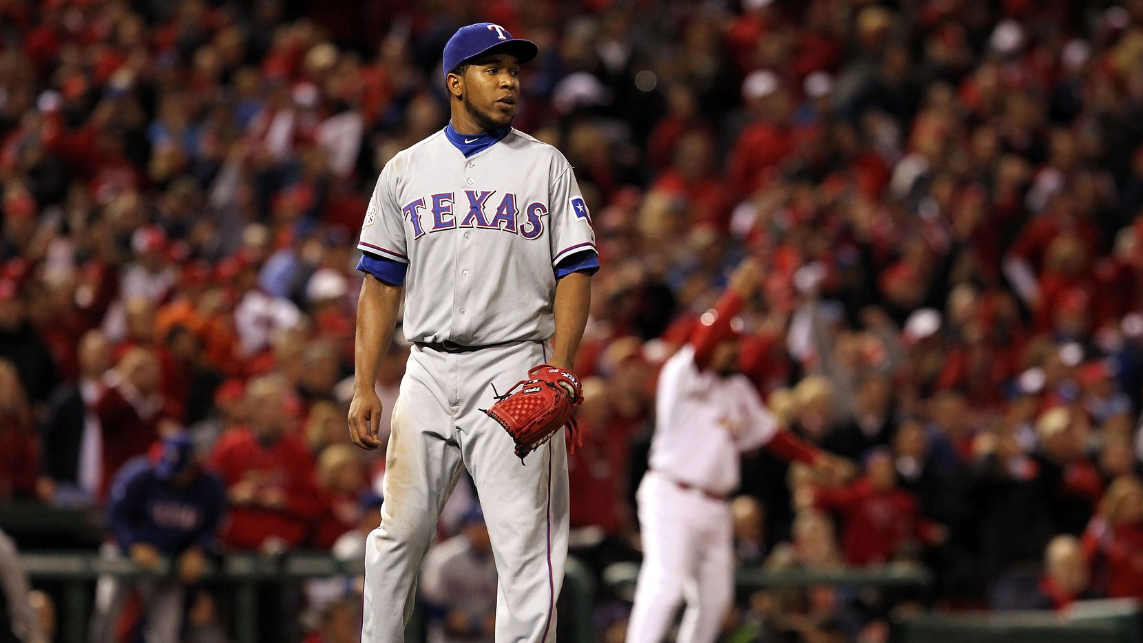 Neftali Feliz #30 of the Texas Rangers reacts after giving up a game tying two-run RBI triple to David Freese #23 of the St. Louis Cardinals in the bottom of the ninth during Game Six of the MLB World Series at Busch Stadium on October 27, 2011 in St Louis, Missouri.