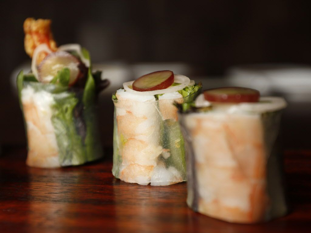 Uchi's biendo  maki --  shrimp tempura spring roll, wrapped in stretchy rice paper.  Filled with lettuce, herbs and cucumber, each slice is topped with a frozen slice of grape and sliver of myoga (ginger bud). It's served with nuoc mam dipping sauce.