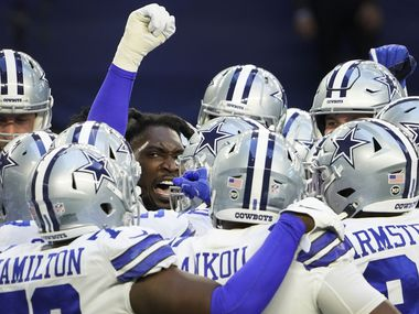 Dallas Cowboys defensive end DeMarcus Lawrence (facing) fires up his teammates before an NFL football game against the Philadelphia Eagles at AT&T Stadium on Sunday, Dec. 27, 2020, in Arlington.