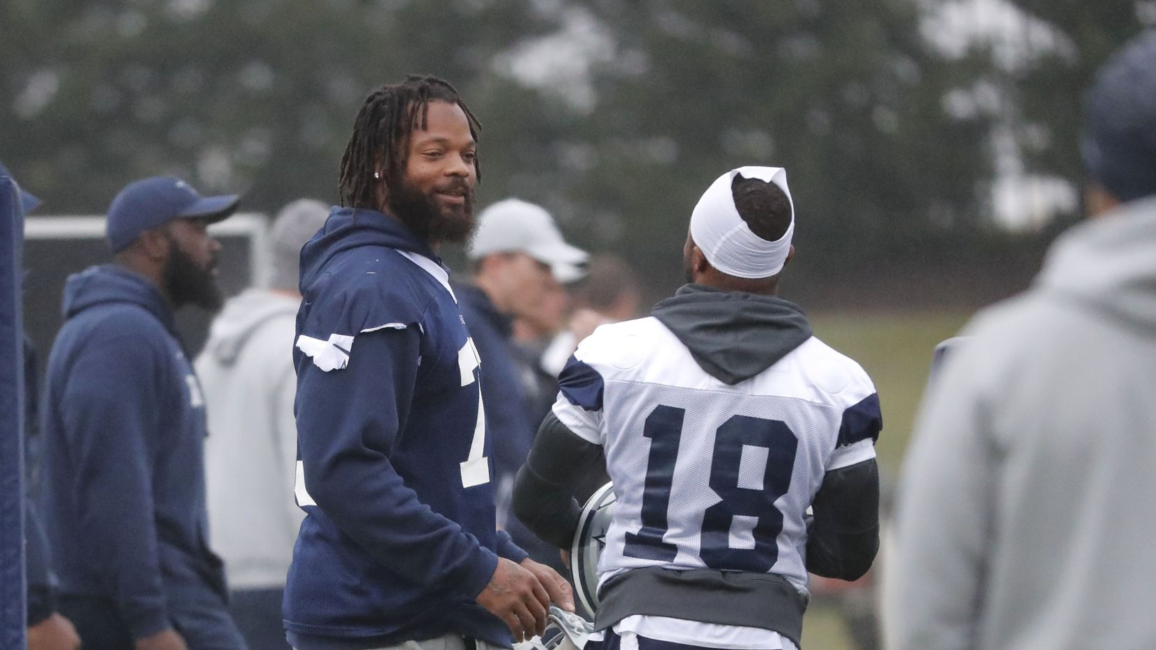 Dallas Cowboys defensive lineman Michael Bennett (79) talks with teammate wide receiver Randall Cobb (18) during an NFL football team practice in Frisco on Oct. 29, 2019. The Cowboys acquired Bennett from the New England Patriots for a conditional late-round draft pick in 2021.