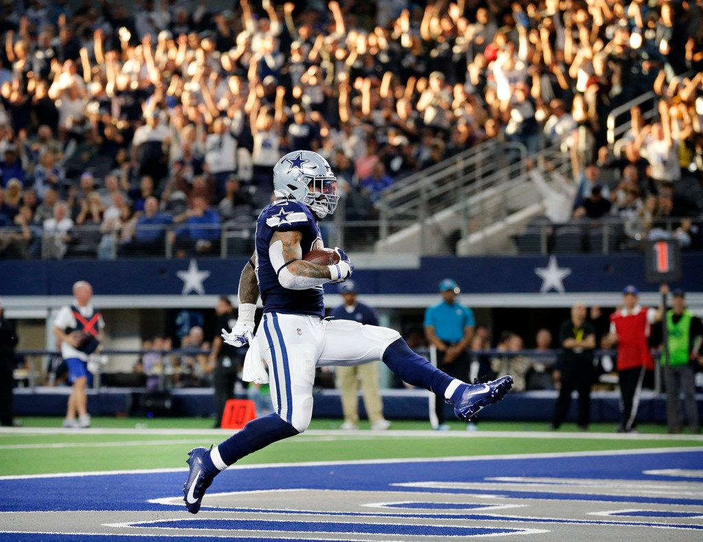 Dallas Cowboys running back Ezekiel Elliott (21) high steps it into the end zone for a second quarter touchdown against the Los Angeles Rams at AT&T Stadium in Arlington, Texas, Sunday, December 15, 2019.