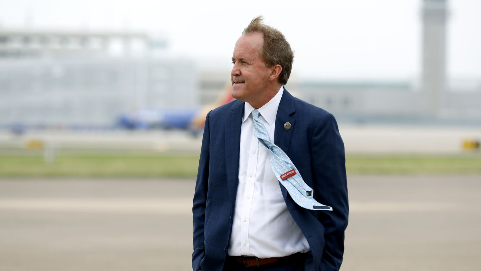 In this June 28, 2020 photo, Texas Attorney General Ken Paxton waits for the arrival of Vice President Mike Pence at Love Field in Dallas.