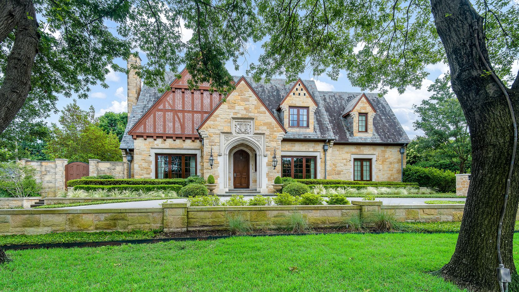 Listed at $3.5 million, the English Tudor-style home at 5638 Stonegate Road has an elevator and a gym with an attached spa with a plunge pool, sauna and steam room.
