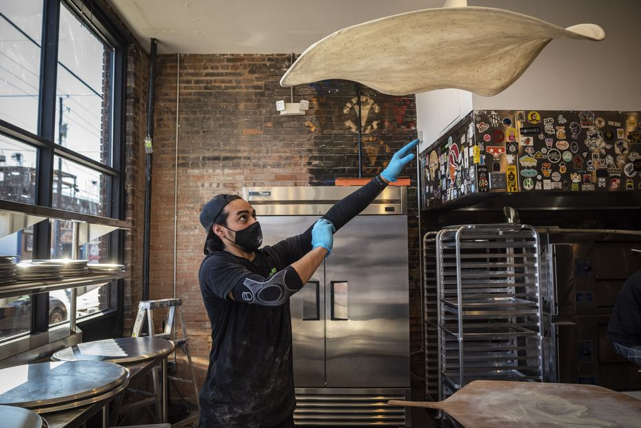 Restaurant manager Francisco Arrona tosses and stretches pizza dough at Serious Pizza in Dallas.
