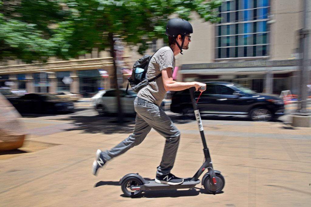 Justin Pierce, 31, tried out a Bird electric scooter Friday  in downtown Dallas.