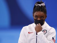USA's Simone Biles watches after pulling out of the competition after the vault event during the artistic gymnastics women's team final at the postponed 2020 Tokyo Olympics at the Ariake Gymnastics Centre on Tuesday, July 27, 2021, in Tokyo, Japan.