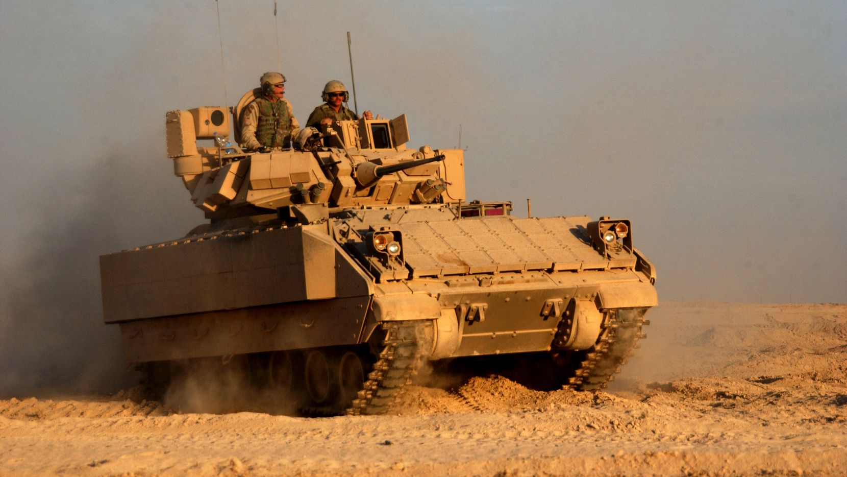 A Bradley Fighting Vehicle rolled back out to the fight after refueling during a combat operation in Fallujah, Iraq, in 2004.