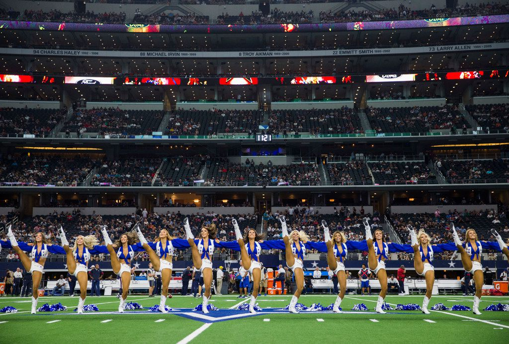 Dallas Cowboys Cheerleaders perform before an Aug. 24 preseason game between the Dallas Cowboys and the Houston Texans.