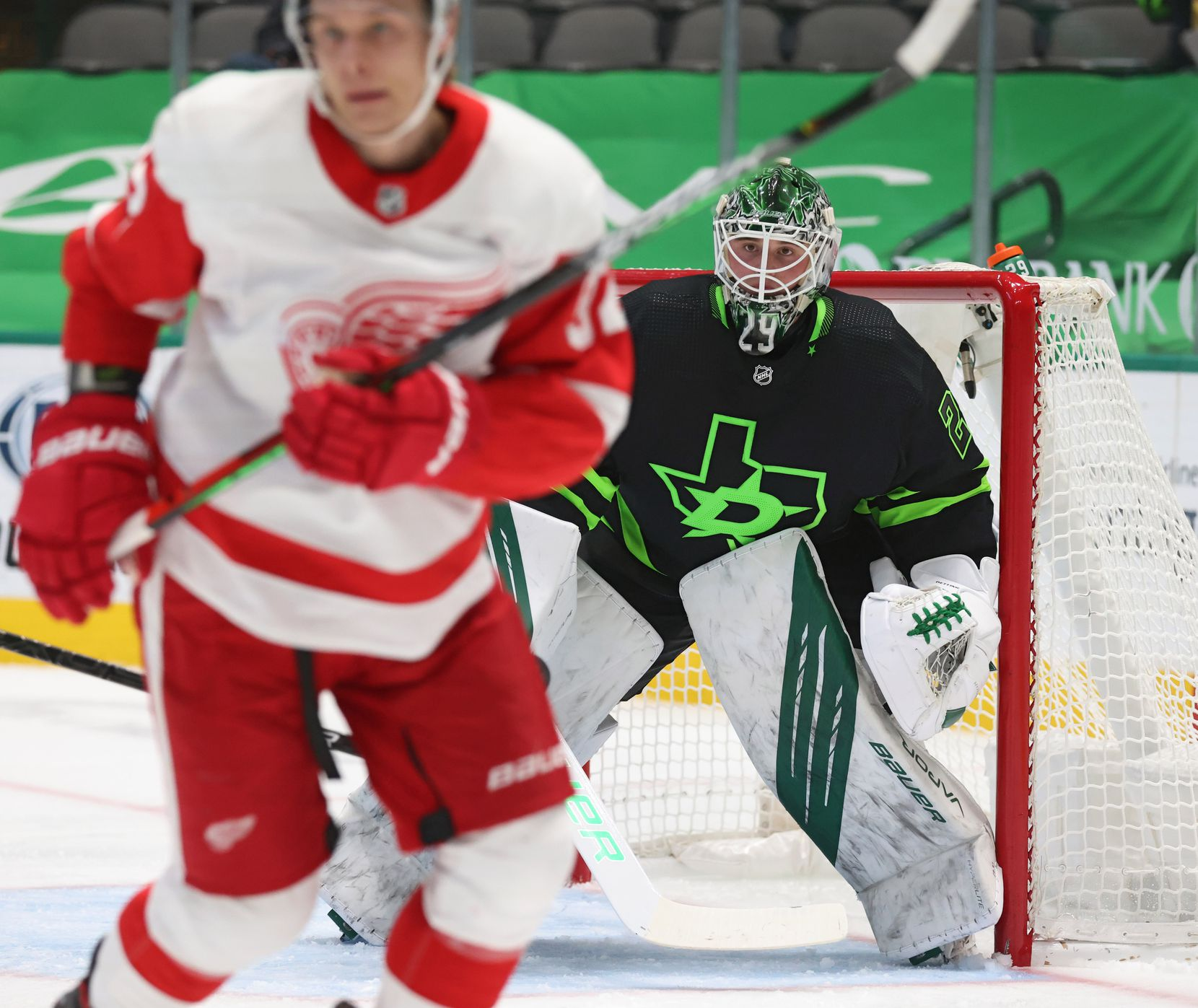 Dallas Stars goaltender Jake Oettinger (29) watches the play develop as he plays against the Detroit Red Wings during the second period of play at American Airlines Center on Thursday, January 28, 2021in Dallas. (Vernon Bryant/The Dallas Morning News)