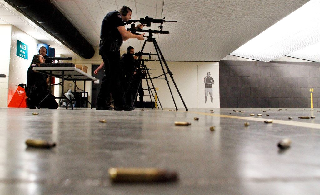John Booth, a school resource officer with the Allen Police Department, sights in his rifle with other officers at the new Allen police gun range at the Collin College Public Training Center in McKinney.