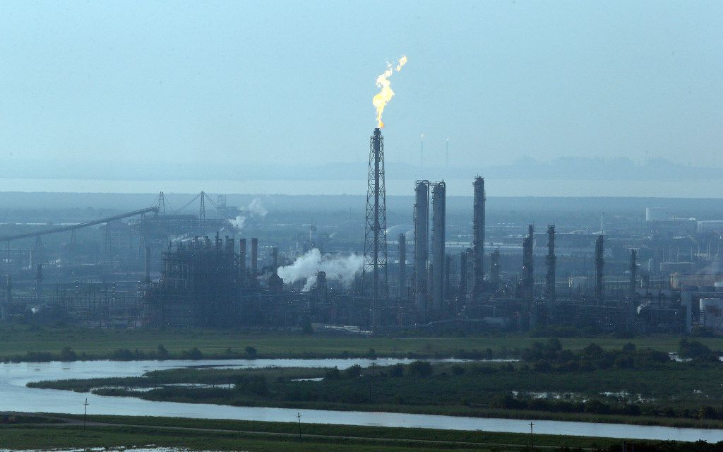 A flare stack puts out a flame at a refinery near an area hit by floodwaters from Tropical Storm Harvey in Port Arthur.