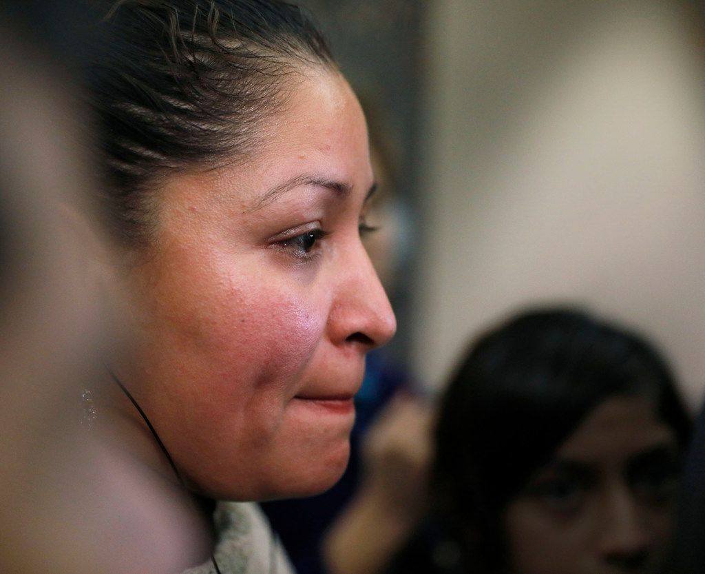 Ana Henriquez, mother of Jose Cruz holds back tears after a 10-year sentenced was given to former Farmers Branch police officer Ken Johnson for the murder of Jose Cruz. The family said 10 years was not enough. Photo taken on Tuesday, January 9, 2018 at the Frank Crowley Courts building in Dallas. (David Woo/The Dallas Morning News)