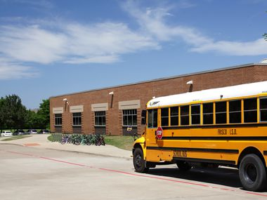 A bus parks for students at Isbell Elementary School in Frisco on April 26, 2019.