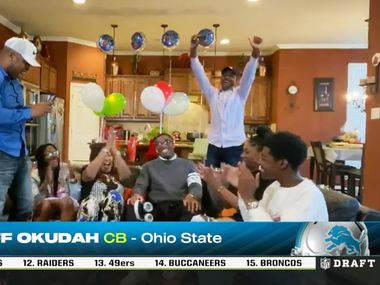 A screenshot of the Detroit Lions third overall pick in the first round of the NFL draft, cornerback Jeff Okudah, of Ohio State with family in Grand Prairie, Texas on Thursday, April 23, 2020. Okudah played at South Grand Prairie High School before attending Ohio State. Due to the coronavirus pandemic the NFL draft was held virtually. (ESPN)