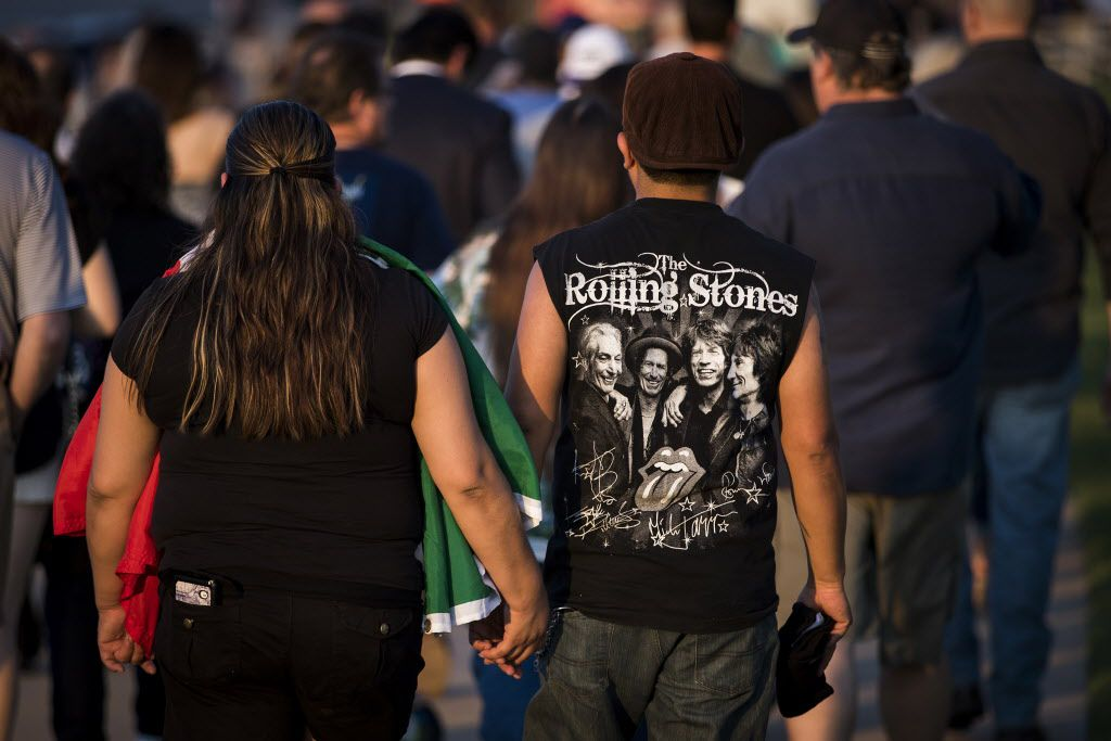 Fans walk toward the stadium before the Rolling Stones concert at AT&T Stadium on Saturday, June 6, as part of their Zip Code Tour of North America.