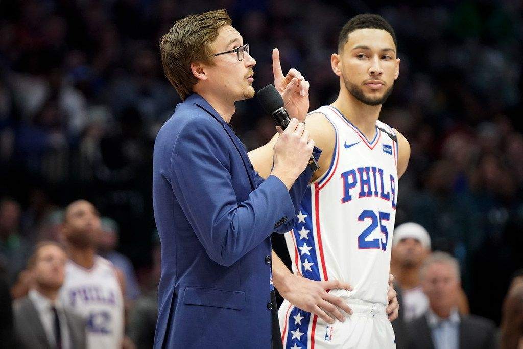 Dallas Mavericks player Ryan Broekhoff stands with Philadelphia 76ers guard Ben Simmons as they appeal to the crowd to donate to support people affected by bushfires in Australia before an NBA basketball game at American Airlines Center on Saturday, Jan. 11, 2020, in Dallas. (Smiley N. Pool/The Dallas Morning News)