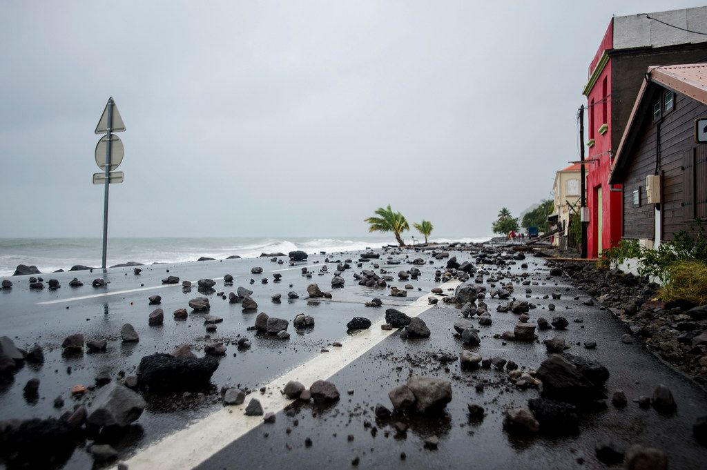 A picture shows rocks swept by strong waves onto a road in Le Carbet, on the French Caribbean island of Martinique, after it was hit by Hurricane Maria, on September 19, 2017. Hurricane Maria smashed into the eastern Caribbean island of Dominica on September 19, with its prime minister describing devastating damage as winds and rain from the storm also hit territories still reeling from Irma. Martinique, a French island south of Dominica, suffered power outages but avoided major damage. / AFP PHOTO / Lionel CHAMOISEAULIONEL CHAMOISEAU/AFP/Getty Images