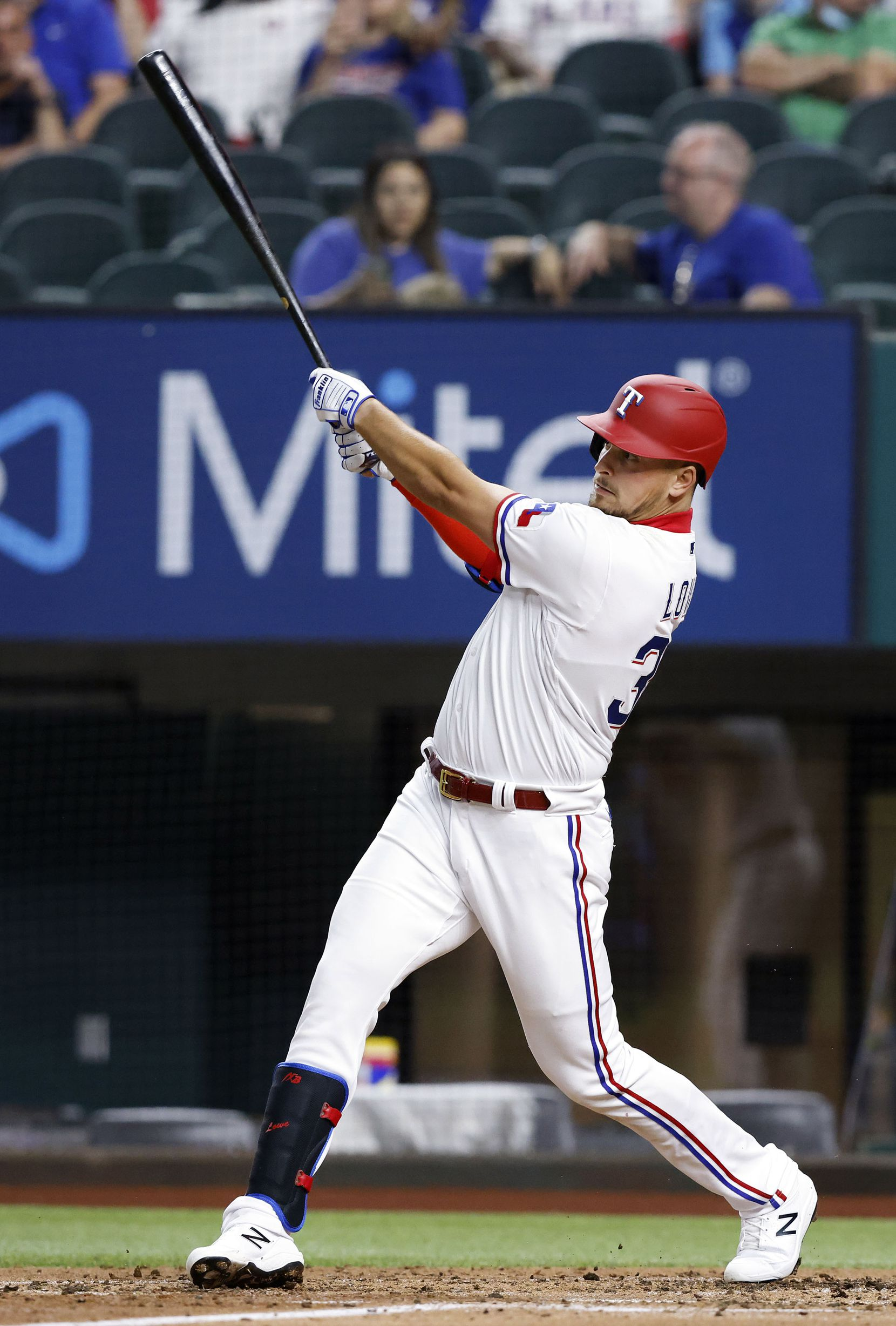 Texas Rangers batter Nate Lowe (30) connects on a two-run homer during third inning against the Toronto Blue Jays at Globe Life Field in Arlington, Tuesday, April 7, 2021. (Tom Fox/The Dallas Morning News)