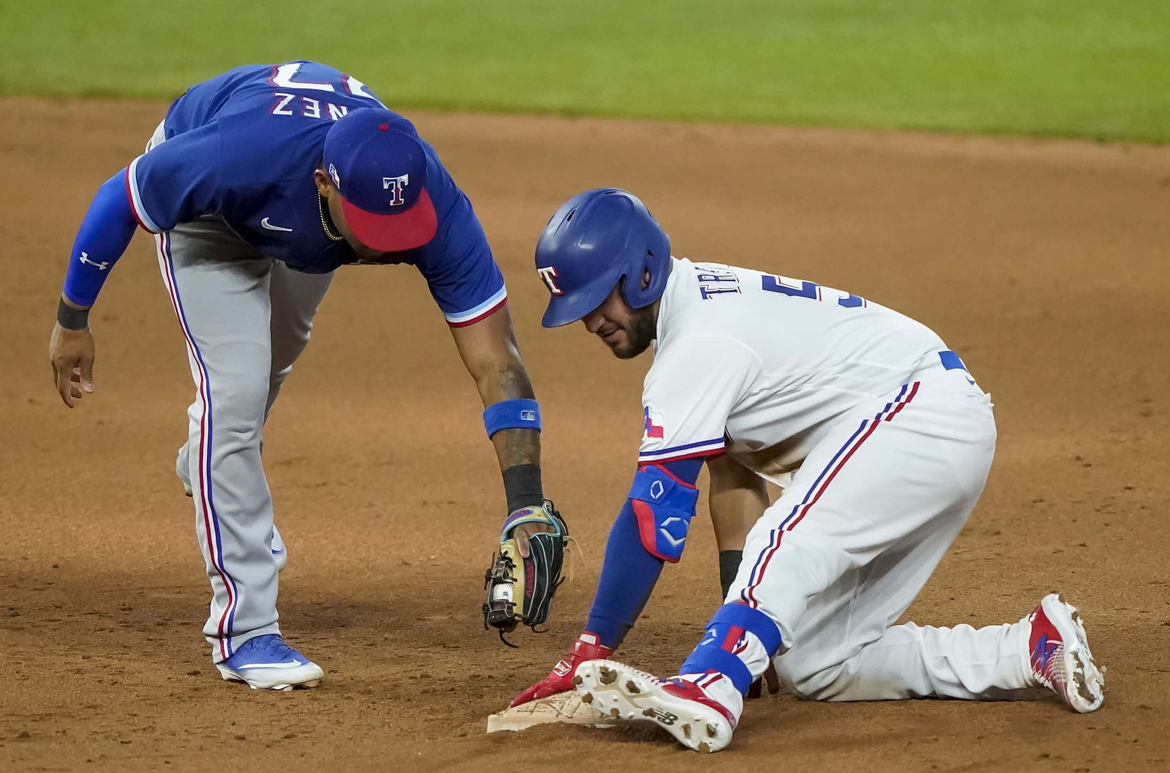 Catcher Jose Trevino is safe at second base with a double ahead of the tag from infielder Andy Ibanez in an intrasquad game during Texas Rangers Summer Camp at Globe Life Field on Saturday, July 18, 2020.