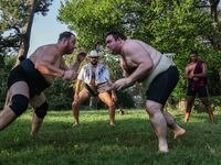 Corey Morrison (middle) and Jonathan Flowers (right), observe Jared Tadlock (left) and Drew Bramlett as they start sumo wrestling practice at Kidds Springs Park on Sept. 1
