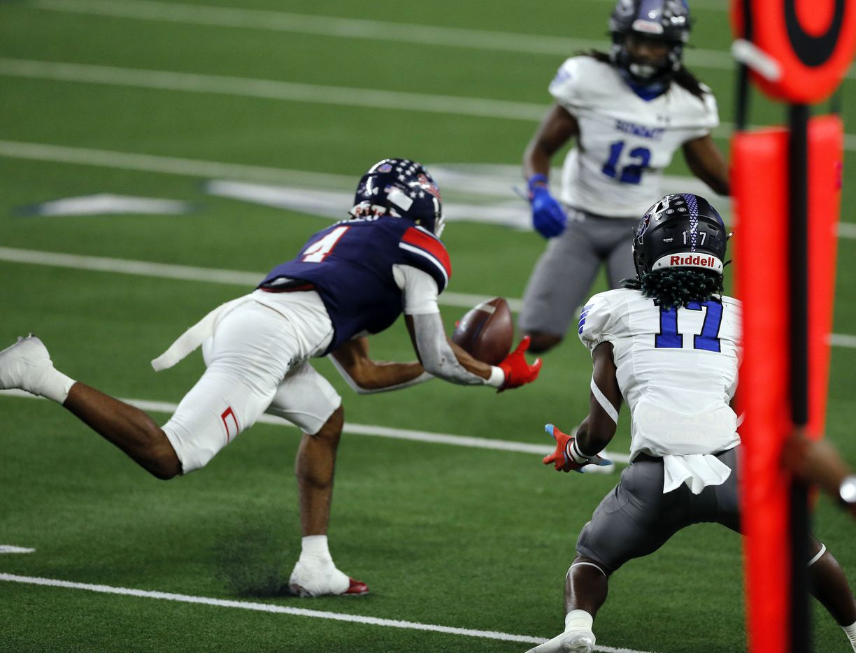 Denton Ryan's Ty Marsh (4) intercepts a pass in front of Mansfield Summit's D'szarion Brown (17) during the first half of the Class 5A Division I state semifinal football playoff gameat AT&T Stadium in Arlington on Friday, January 8, 2021. (John F. Rhodes / Special Contributor)