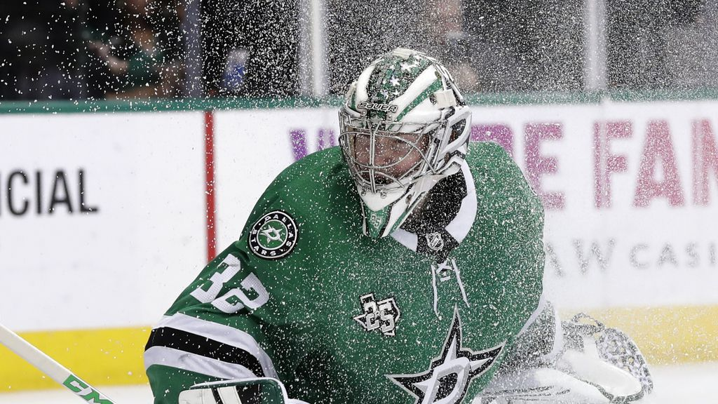 Dallas Stars goalie Kari Lehtonen (32) of Finland looks for the puck through a spray of snow during an NHL hockey game against the Ottawa Senators in Dallas, Monday, March 5, 2018. (AP Photo/Tony Gutierrez)
