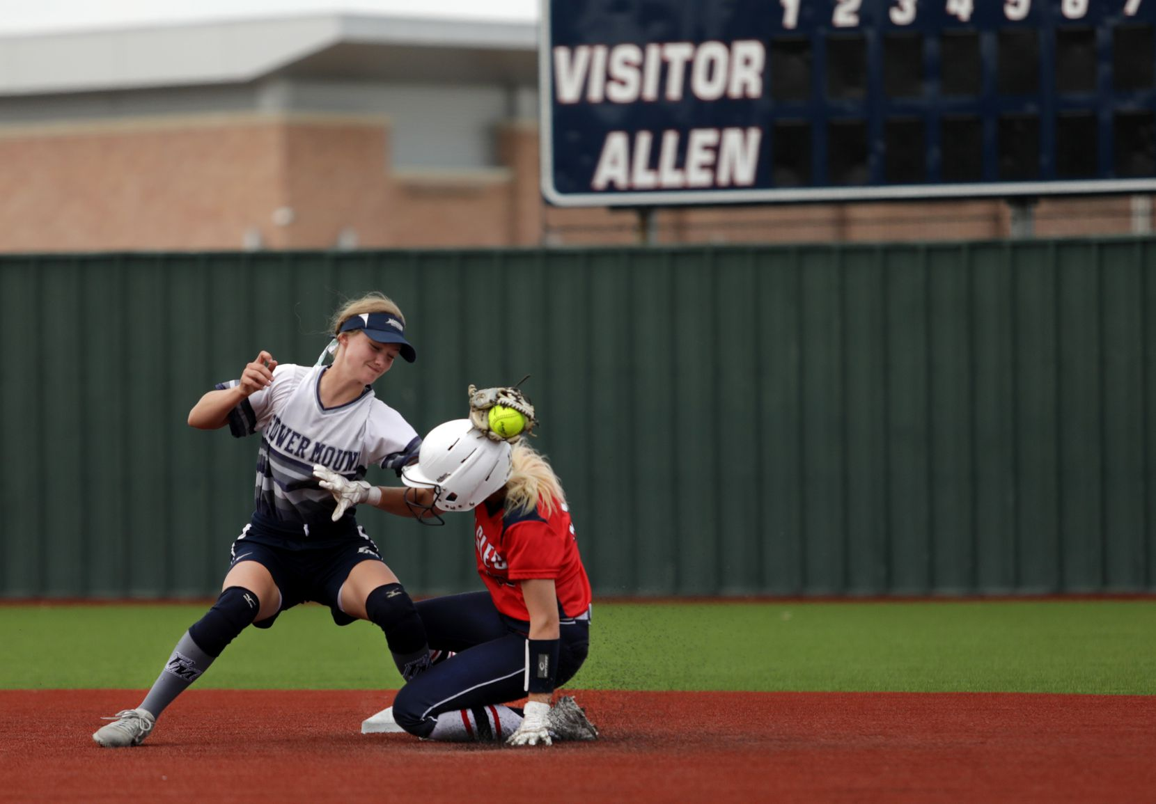 Flower Mound High School player #6, McKenna Andrews, tries to stop Allen High School player #13, Maddie Slaughter, from taking second base during a softball playoff game at Allen High School in Allen, TX, on May 15, 2021. (Jason Janik/Special Contributor)