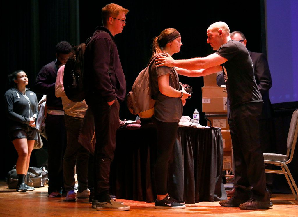 Suicide survivor, activist, storyteller and filmmaker Kevin Hines (right) comforts a student who approached him during a book signing at Texas A&M University Commerce.  His keynote address was part of mental health awareness day on campus in Commerce on April 2, 2018.