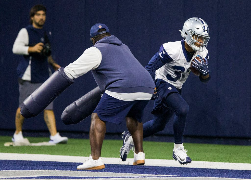 Dallas Cowboys running back Tony Pollard (36) runs a drill with running backs coach Gary Brown during a Dallas Cowboys OTA practice on Wednesday, May 29, 2019 at The Star in Frisco. (Ashley Landis/The Dallas Morning News)