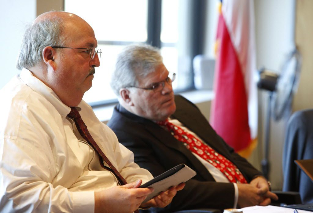 Richard Tettamant, Adminstrator of the Dallas Police and Fire Pension System (left) and Don Rohan (right), at a board meeting in Dallas on Thursday, December 13, 2012.  (Lara Solt/The Dallas Morning News)