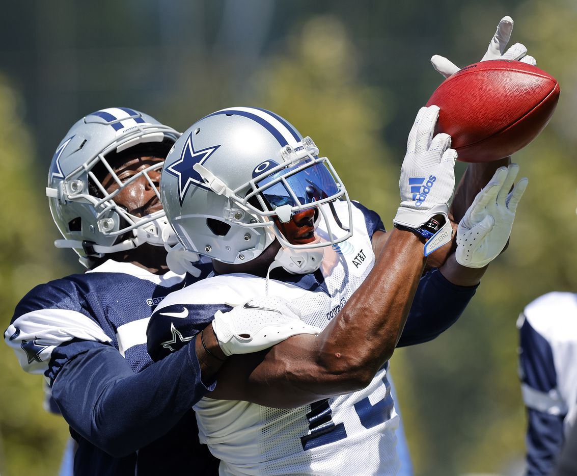 Dallas Cowboys wide receiver Michael Gallup (13) catches a ball as he fights off cornerback Deante Burton (33) during Training Camp drills at The Star in Frisco, Texas, Tuesday, August 24, 2021.(Tom Fox/The Dallas Morning News)