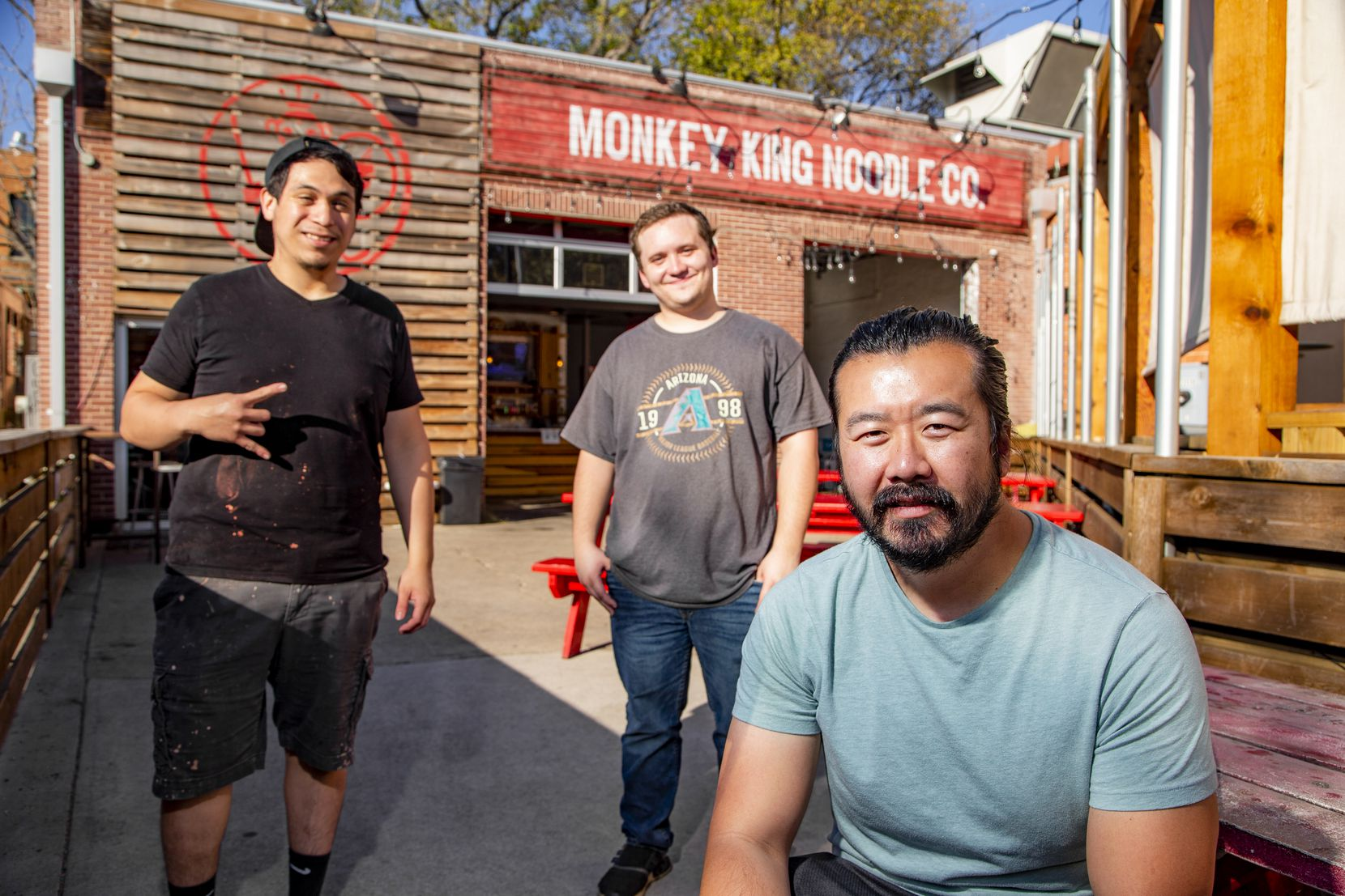 (L to R) Monkey King Noodle Company Kitchen Manager Kristian Pena, Front of House manager Evan Mitzel and Operating Owner Andrew Chen at the Deep Ellum location